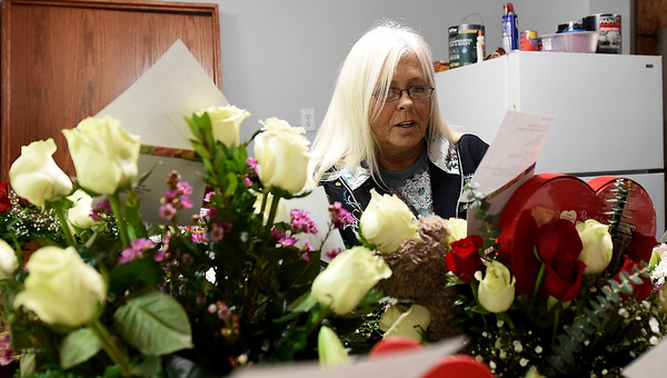 Floral designer Cindy Fox gives bouquets a final inspection before delivery on Tuesday at Don Davis Florist as local florists gear up for a busy Valentine's week.<br /> Globe | Laurie Sisk