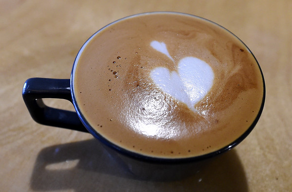 A delicate heart of cream sits at the surface of a cappucino at the Bearded Lady Roasters coffee shop on Thursday. Owner Adam Francis has grown from roasting his popular coffee to also opening his own shop at 218 S. Main St.<br /> Globe | Laurie Sisk