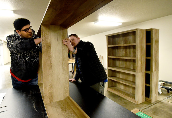 Carl Junction High School Spanish National Honor Society members Brett Hole, 17 and Carson Cowan, 16 assemble shelves at Watered Gardens on Saturday. About 25 students from the society volunteered their time on Saturday for a variety of projects at the shelter.<br /> Globe | Laurie SIsk