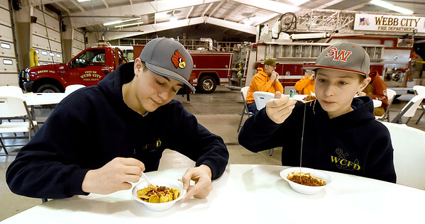 From the left: Brothers Skylar Denton, 15 and Chayse Denton, 11, sample the fare at the 2019 City of Webb City Chili Cook-off on Thursday at the Webb City Fire Department. Entires included 17 chilis and three soups. Prizes were awarded in four divisions:  People's Choice, Restaurants, Amateurs and Non-chili, with proceeds benefitting the Webb City Senior Center.<br /> Globe | Laurie SIsk