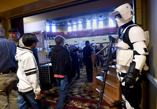 A stormtrooper watches as guests pass from room-to-room during the Neosho Arts Council's Artcon on Saturday at the Neosho Civic Center. Proceeds from the event will be used to restore historic murals in downtown Neosho.<br /> Globe | Laurie Sisk
