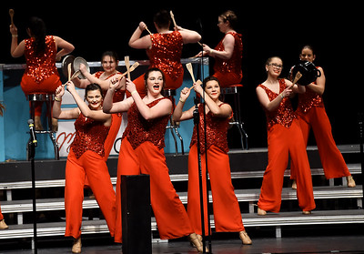 Members of Nevada High School's Soundsational Singers perform for the crowd on Saturday during the In the Spotlight Show Choir Invitational on Saturday at Joplin High School. The two-day event featured 27 choirs from area schools. Globe | Laurie Sisk