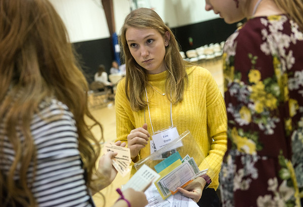 Evie Cross, a senior at Carl Junction High School, tries to balance her family's resources during Wednesday's poverty simulation at the Boys and Girls Club of Southwest Missouri.<br /> Globe | Roger Nomer