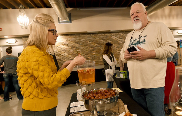 Lisa Wood checks out the appetizers at the Culver Creek Trading Company's booth as owner Jon Tupper looks on during the 2019 Bridal Bash at the Roxy Event Center on Saturday.<br /> Globe   Laurie Sisk