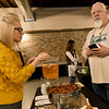 Lisa Wood checks out the appetizers at the Culver Creek Trading Company's booth as owner Jon Tupper looks on during the 2019 Bridal Bash at the Roxy Event Center on Saturday.<br /> Globe | Laurie Sisk