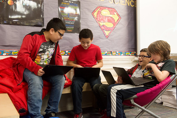 (from left) Omar Limon, Landon Stephens, Bradford Culler and Jack Danley, fifth graders at West Central Elementary, work on Chromebooks on Feb. 1 at the school.<br /> Globe | Roger Nomer