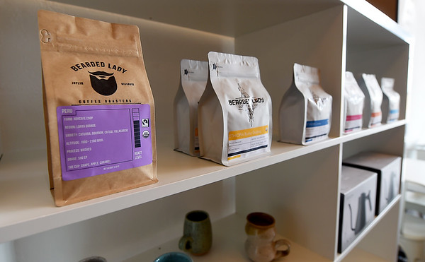 Bags of fresh roasted coffee line the shelves at Bearde Lady Roasters on Thursday. Owner Adam Francis has grown from roasting his popular coffee to also opening his own shop at 218 S. Main St.<br /> Globe | Laurie Sisk