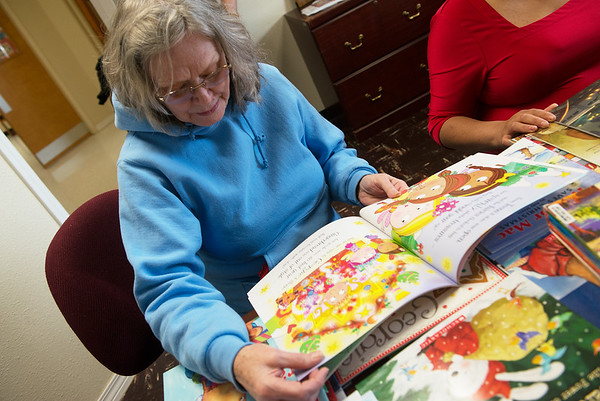 Patricia Hill reads a book provided by a book drive at Crowder College on Wednesday.<br /> Globe   Roger Nomer