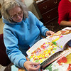 Patricia Hill reads a book provided by a book drive at Crowder College on Wednesday.<br /> Globe | Roger Nomer