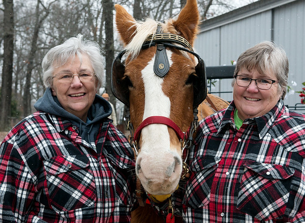 Christina Mackey, left, and Georgia Henderson will offer horse-driven carriage rides in Neosho with Gabby.<br /> Globe | Roger Nomer