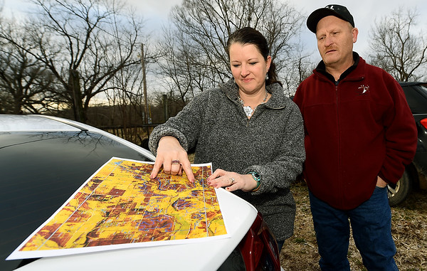 Mark and Jennifer Renfro look at a map of their property near Diamond on Tuesday. The land is targeted for a Missouri American Water proposed reservoir. The land has been in the Renfro family for 170 years. Globe | Laurie Sisk