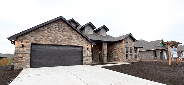 The new St. Jude's Dream Home at 1752 Kent Dr. in Webb City sits nearly complete on Tuesday. The $275,000 home will be raffled off on May 22. Other prizes include a $10,000 VISA gift card, a $10,000 home accessories package and a Husqvarna automower.<br /> Globe | Laurie Sisk