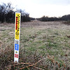 A large petroleum pipeline runs through the center of Mark and Jennifer Renfro's Diamond property on Tuesday. The land is targeted for a Missouri American Water proposed reservoir and has been in the Renfro family for 170 years.<br /> Globe | Laurie Sisk