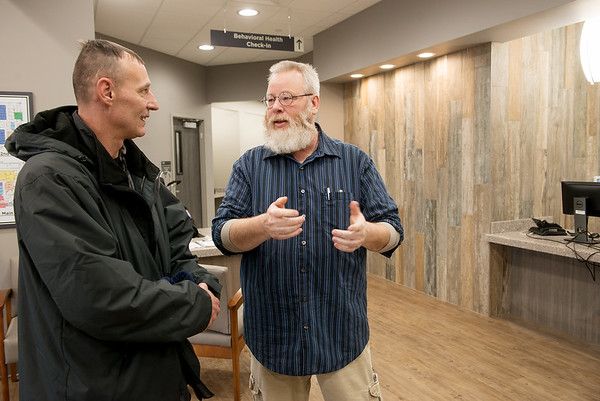 Robert Wood, peer support specialist, right, welcomes David Driscoll to the new Joplin VA Clinic on Monday.<br /> Globe | Roger Nomer