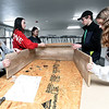 From the left: Carl Junction High School Spanish National Honor Society members Abby Rogers, 16, Abbi Washburn, 17, Gracie Distler, 17, Ethan Brown, 17 and Tatum Graham, 18, help build shelves at Watered Gardens on Saturday. About 25 students from the society volunteered their time on Saturday for a variety of projects at the shelter.<br /> Globe | Laurie SIsk
