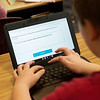 Triton Mayo, a fifth grader at West Central Elementary, works on a Chromebook on Feb. 1 at the school.<br /> Globe | Roger Nomer