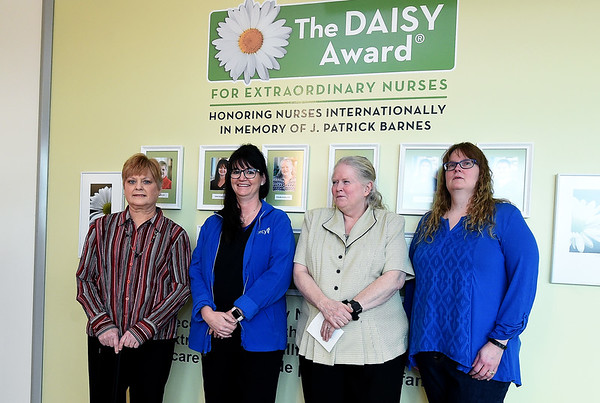 Four of the eight Daisy Award recipients from Mercy Joplin stand near a new wall honoring their service during an unveiling of the wall on Tuesday at Mercy Hospital. From the left: Judi Pim, Cindy Harner, Pricilla Atwood and Jeanette Cline. The international award recognizes extraordinary wok by those in the nursing profession.<br /> Globe | Laurie Sisk