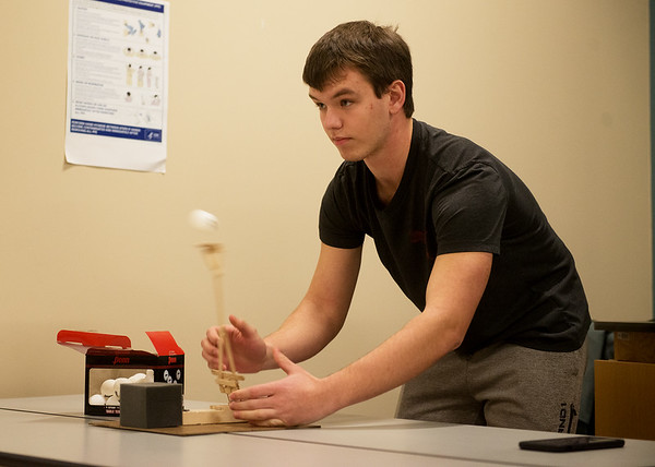 Kaleb Roberts, Webb City High junior, competes with his team's ping pong ball launcher during Engineering Day at Crowder College on Wednesday.<br /> Globe | Roger Nomer