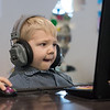 Noah Scacewater, 4, Joplin, spends a frigid Friday playing on a computer at the Joplin Public Libary.<br /> Globe | Roger Nomer