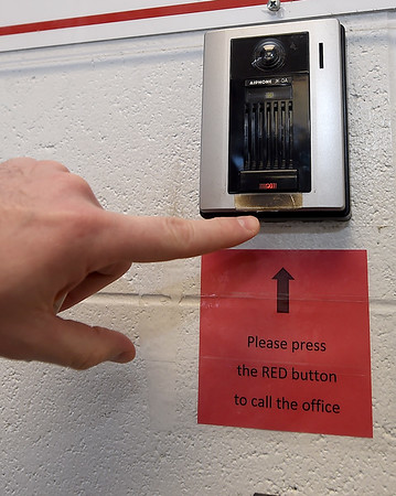 Visitors at Carl Junction High School must use a call button to gain entryinto CJHS.<br /> Globe | Laurie Sisk