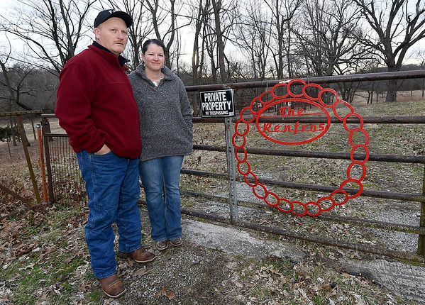 Mark and Jennifer Renfro stand near on an area of their property near Diamond on Tuesday. The land is targeted for a Missouri American Water proposed reservoir. The land has been in the Renfro family for 170 years.<br /> Globe | Laurie Sisk