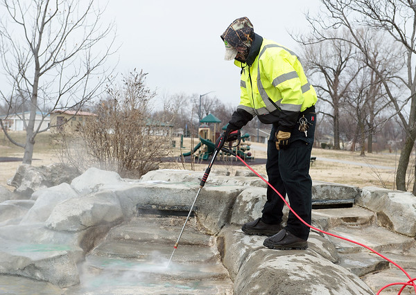 Sam Denton, with Joplin Parks and Rec, cleans off graffiti at Parr Hill Park on Monday.<br /> Globe | Roger Nomer