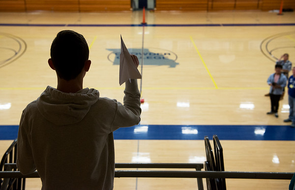 Drake Miller, a Webb City High sophomore, competes in a paper airplance accuracy competition during Engineering Day at Crowder College on Wednesday.<br /> Globe   Roger Nomer