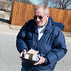 Mike Howard braces against a cold wind as he delivers Meals on Wheels on Friday in Joplin.<br /> Globe | Roger Nomer