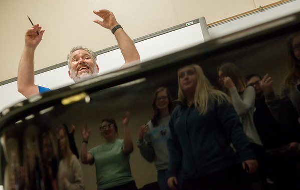 David Sharlow leads the Missouri Southern Concert Chorale through warmups on Wednesday at MSSU.<br /> Globe   Roger Nomer