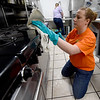 Carl Junction High School Spanish National Honor Society adviser Erin Douglas joins her students as they clean the kitchen at Watered Gardens on Saturday. About 25 students from the society volunteered their time on Saturday for a variety of projects at the shelter.<br /> Globe | Laurie SIsk