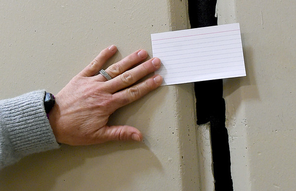 "Columbia Elementary Principal Shally Lundien uses a 3"" x 5"" index card on Wednesday to illustrate a large floor-to-ceiling crack in the school's recently constructed safe room.<br /> Globe 