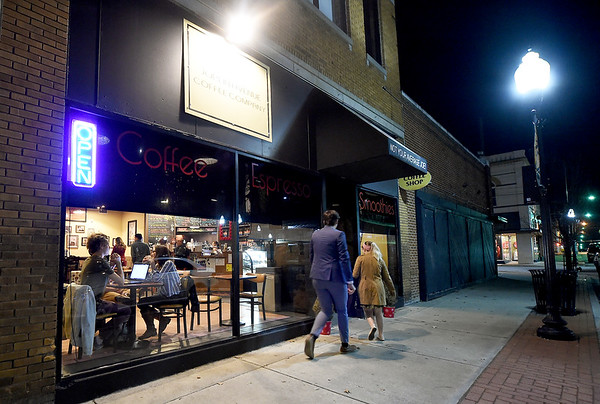 Patrons make their way into the Joplin Avenue Coffee Company on Thursday night.<br /> Globe | Laurie Sisk