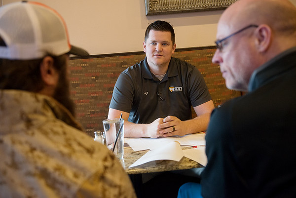 (from left) Justin Maggard, board member of Charlie 22 Outdoors, AJ Stock, vice president, and Scott Hettinger, president talk about veteran's applications to the program over lunch at Cantina Bravo on Friday, Feb. 15.<br /> Globe   Roger Nomer