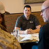 (from left) Justin Maggard, board member of Charlie 22 Outdoors, AJ Stock, vice president, and Scott Hettinger, president talk about veteran's applications to the program over lunch at Cantina Bravo on Friday, Feb. 15.<br /> Globe | Roger Nomer