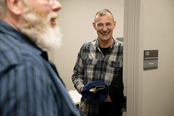 David Driscoll, right, talks about his excitement for more treatment options with Robert Wood, peer support specialist, at the new Joplin VA Clinic on Monday.<br /> Globe | Roger Nomer