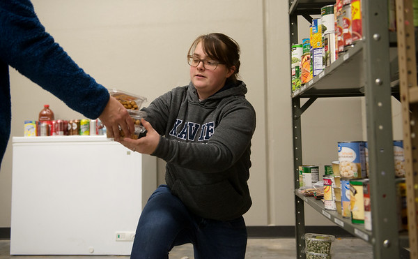 Michele Kattine, a Missouri Southern senior from Georgetown, Ohio, stocks shelves at the Lion Co-Op on Wednesday.<br /> Globe | Roger Nomer
