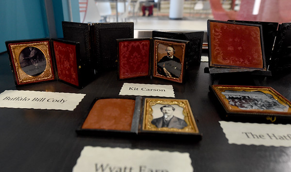 Old photos of infamous wild west figures rest inside a case with other photos as part of an Allen Shirley collection of about 50 famous figures captured in three different types of photographic processes now on display at the library.<br /> Globe | Laurie Sisk