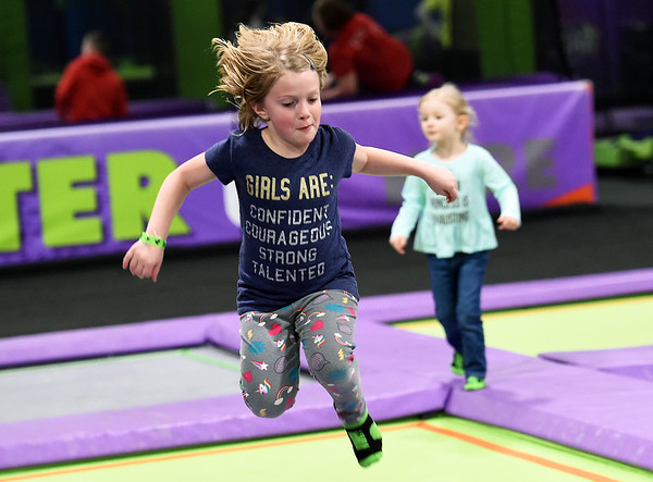 Six-year-old Alleigh Hailey bounces her way down a strip of trampolines as she escapes cold conditions outside with a day of play inside the Soar Trampoline Park on Thursday.<br /> Globe | Laurie SIsk