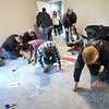 Sponsors, St. Jude families and builders write warm messages on the floor of the new St. Jude's Dream Home, which will be raffled on May 22. The $275,000 home will be reaffled off on May 22. Other prizes include a $10,000 VISA gift card, a $10,000 home accessories package and a Husqvarna automower.<br /> Globe | Laurie Sisk