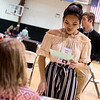 Mary Pham, senior at McAuley Catholic High School, considers a tough choice while visiting a lender during Wednesday's poverty simulation at the Boys and Girls Club of Southwest Missouri.<br /> Globe | Roger Nomer