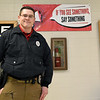 Carl Junction School Resource Officer Danny Conway stands beside one of numerous posters urging students to play their part in school safety at Carl Junction High School.<br /> Globe | Laurie Sisk