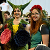 From the left: Deborah Prine, of Neosho and Janie Robinson, of Joplin, dress as Pokemon characters Ivysaur and Roselia during the Neosho Arts Council's Artcon on Saturday at the Neosho Civic Center. Proceeds from the event will be used to restore historic murals in downton Neosho.<br /> Globe | Laurie Sisk