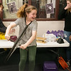 Kennedy Myers, a fourth grader at Thomas Jefferson Independent Day School, gets a lesson in intertia as she rotates on a turntable using a spinning bike wheel on Friday. The Missouri Southern student group called Women in Science gave the presentation at the school with experiments in different scientific areas and read to students about accomplished female scientists in history.<br /> Globe | Roger Nomer