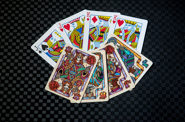 Liquid Blue deck compared with regular playing cards<br /> Globe | Roger Nomer