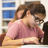 Lucy Perez, a fifth grader at West Central ELementary, works on a Chromebook on Feb. 1 at the school.<br /> Globe | Roger Nomer