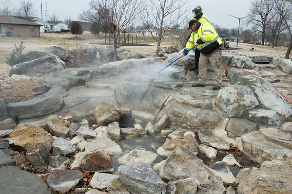 Darby Giberti, right, and Sam Denton, with Joplin Parks and Rec, clean off graffiti at Parr Hill Park on Monday.<br /> Globe | Roger Nomer