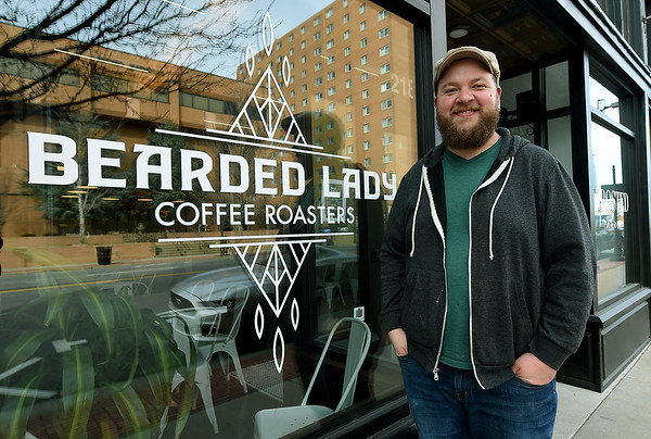 Bearded Lady owner Adam Francis stands outside his shop on Thursday. Francis has grown from roasting his popular coffee to also opening his own shop at 218 S. Main St.<br /> Globe | Laurie Sisk