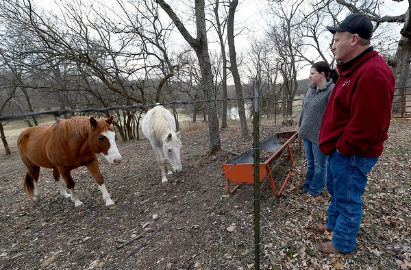Mark and Jennifer Renfro stand near two of their horses on their property near Diamond on Tuesday. The land is targeted for a Missouri American Water proposed reservoir. The land has been in the Renfro family for 170 years.<br /> Globe | Laurie Sisk
