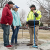 Douglas and Katrin Herd talk with Darby Giberti during cleanup at the site of their son's memorial in Parr Hill Park.<br /> Globe | Roger Nomer