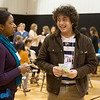 Richie Joseph, senior at Thomas Jefferson Independent Day School, gives a nervous laugh while talking to Alana Hickman portraying a police officer during Wednesday's poverty simulation at the Boys and Girls Club of Southwest Missouri.<br /> Globe | Roger Nomer